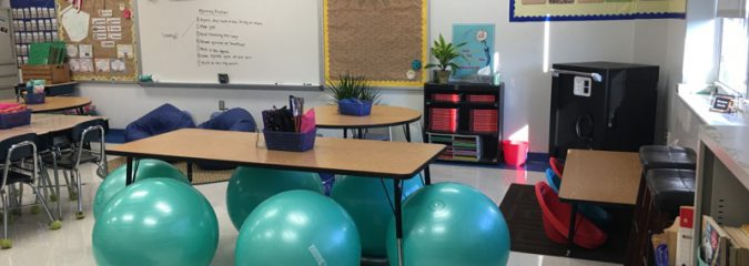 Exercise balls around a table in an elementary classroom