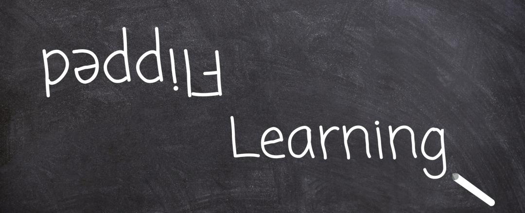 """Chalkboard with """"flipped learning"""" written on it in a chalk font"""