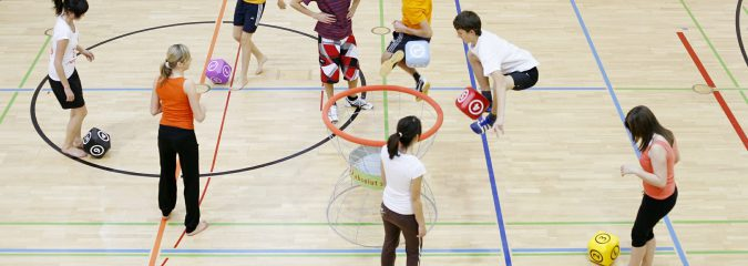 A group of students playing a sport during gym class